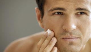 2018 Close-up of young man applying shaving cream